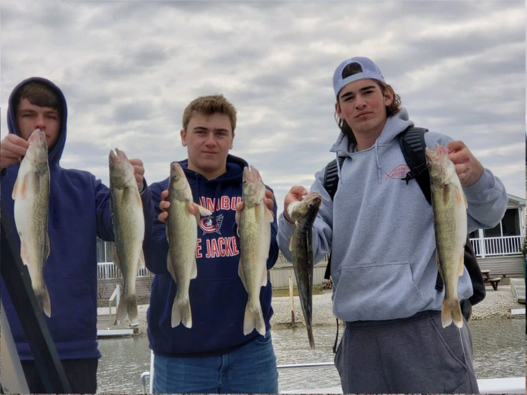 3 Young Men With Walleye