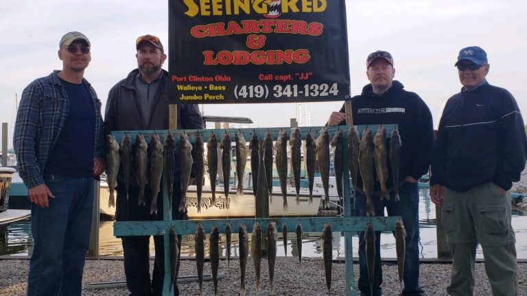 4 men with walleye and banner