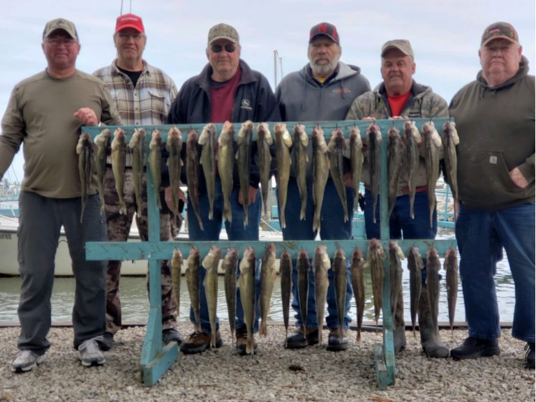 6 men with fish