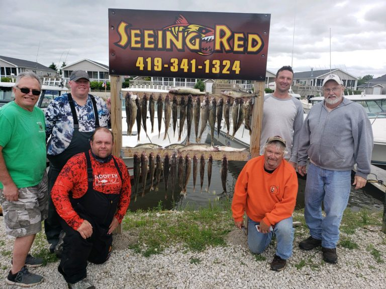 5 men showing off fish they caught in July 2019