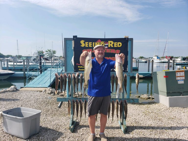 Single Man showing off 2 of his catch after charter fishing