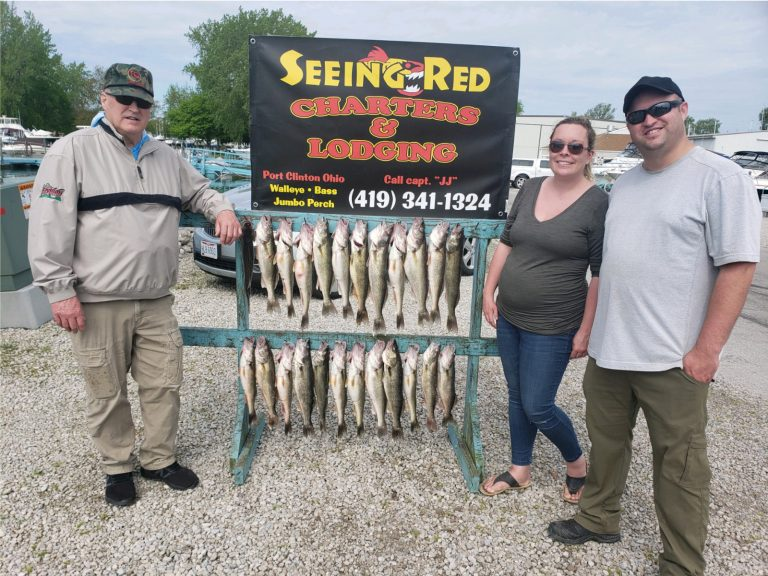 Couple with family member with walleye from Lake Erie 2020