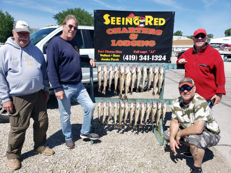 4 men showing off their catch with Seeing Red Charters June 2020
