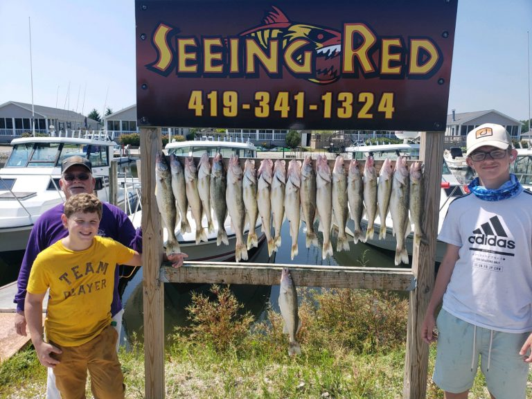 Young Fishermen showing off their walleye catch from charter fishing July 9, 2020