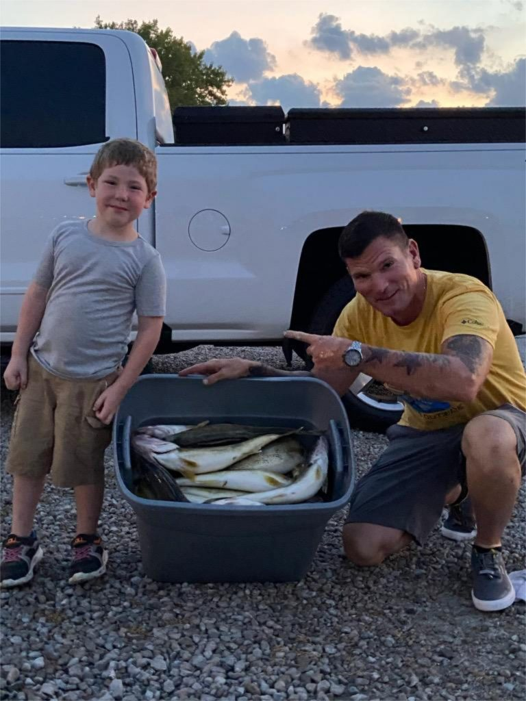 Captain JJ Helping a Young Fishermen Show Off His Walleye